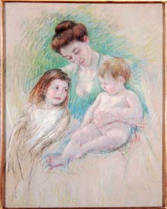 "Mary Cassatt (1844-1926). ""Mother Looking Down, Embracing Both Her Children"" (1905-08). Pastel, 36 1/4 x 29 inches. Gift of the Enid and Crosby Kemper Foundation. Mary Cassatt is best known for her images of mothers and children. In 1872 the Philadelphia-born artist settled permanently in France where she soon became associated with the group of avant-garde artists known as the Impressionists. Interested in light and spontaneity, Cassatt often used pastel because of the freedom it allowed without dealing with the lengthy drying time of paint. As a woman, Cassatt was limit by the social norms of the time that prevented a ""proper"" woman from accessing subject and locations frequently seen in the work of her male contemporaries—nude models, bars, and dance halls. Instead, she depicted the domestic sphere of families and homes more readily accessible to her."